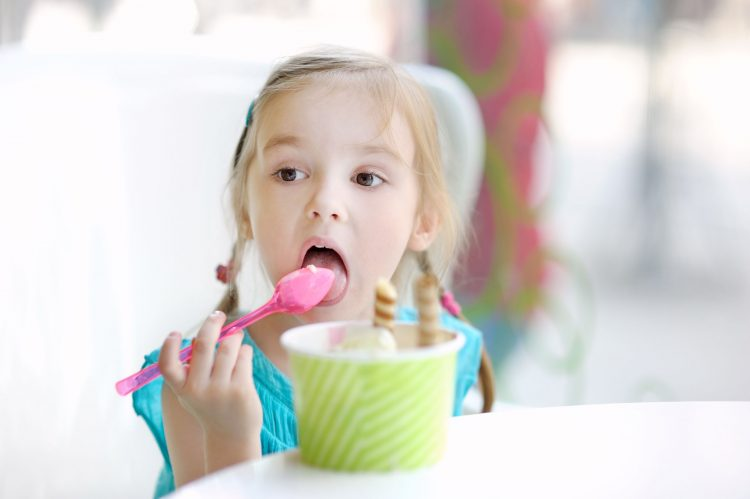 40753841 - adorable little girl eating ice cream at summer